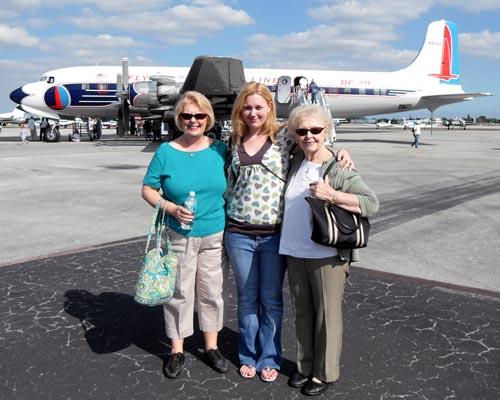 Dec. 2008 - Karen, Donna and Karens mom Esther with the restored  Historical Flight Foundationss Eastern Air Lines DC-7B N802D