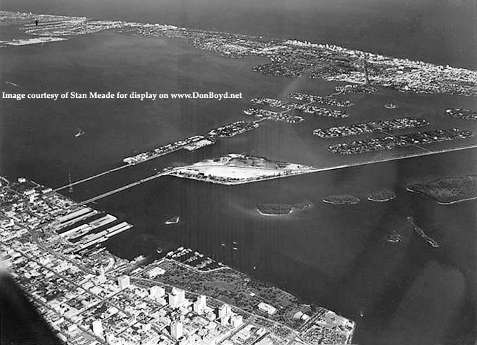 1950s - aerial view looking northeast over downtown Miami, Biscayne Bay and Miami Beach