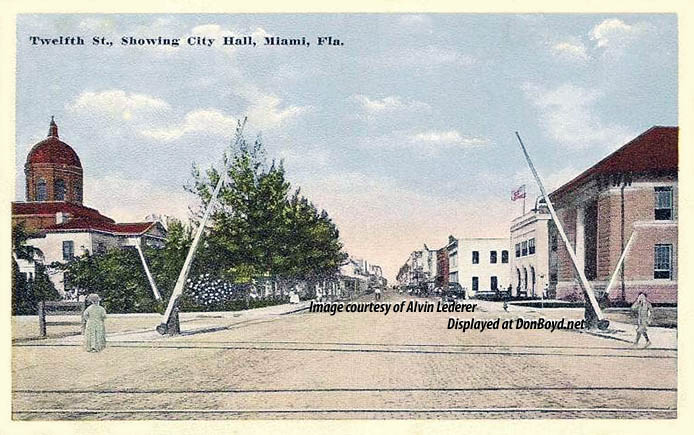 1910 - Twelfth Street (later Flagler) at the railroad tracks with the county courthouse (left) and Miami City Hall (right)