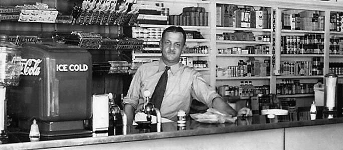 1940s - Harold Hubbard working the counter at Hubbards Kubbard