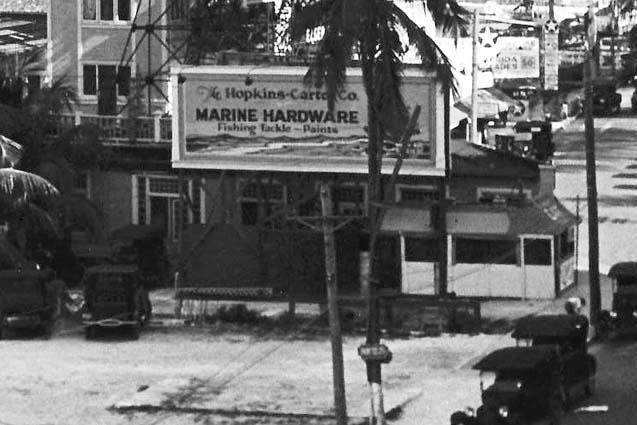 Mid 1920s - a billboard advertising Hopkins-Carter Marine Supply at Elsers Pier