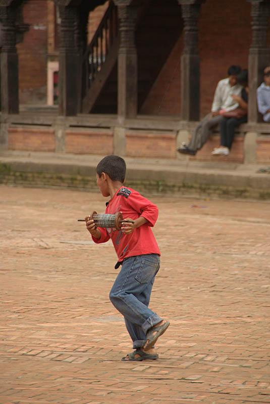 Boy Flying Kite in Durbar Square Bhaktapur