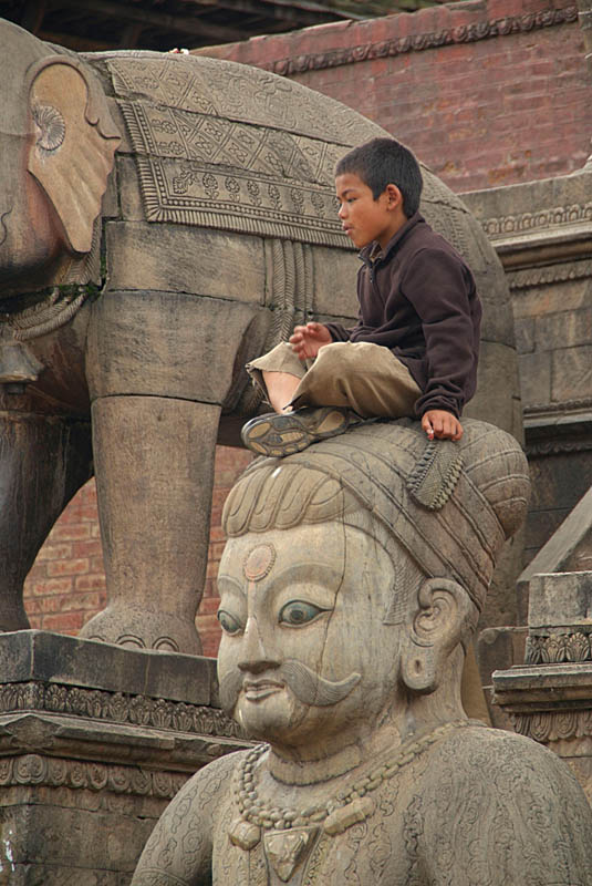 Boy Sitting on Stone Wrestler Bhaktapur