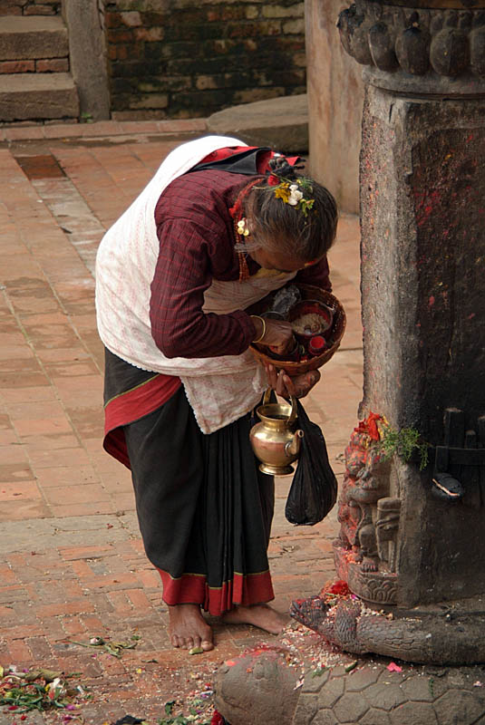 Old Woman Annointing Shrine Bhaktapur