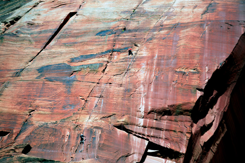Climbers on red rock face slanted.jpg