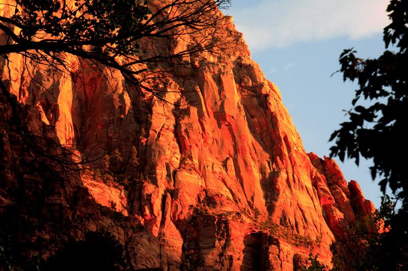 Orange Cliff at Sunset through the trees.jpg