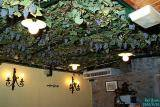 Real grapes on the restaurant ceiling.