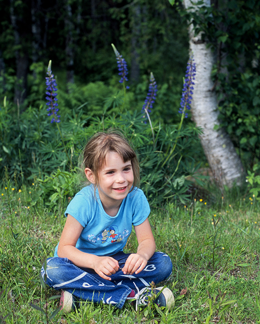 Sara by Birch and Lupines