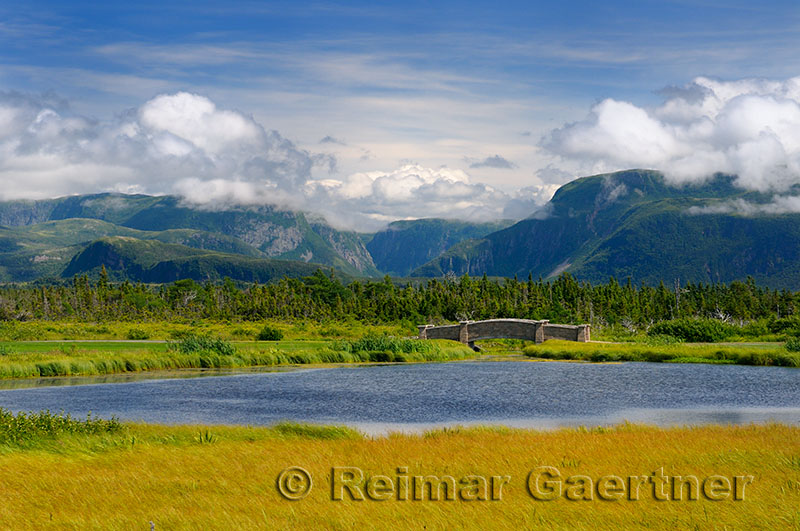 Gros Morne Resort golf course bridge with steep Long Range Mountains of the National Park