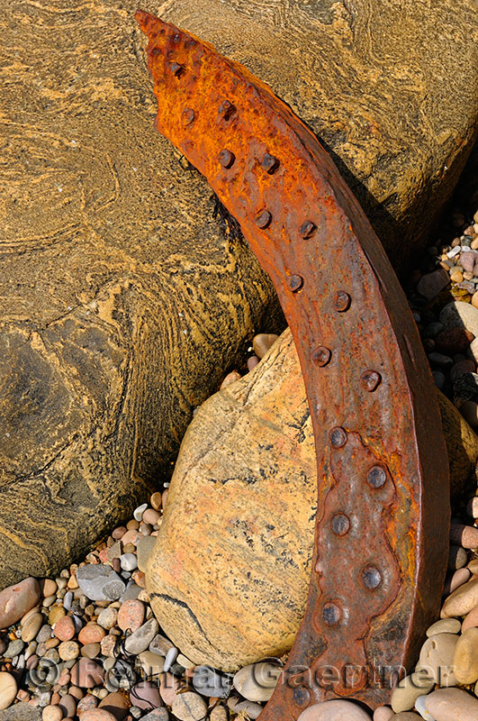 Abstract detail of a rusted piece of the SS Ethie shipwreck on the beach at Martins Point Newfoundland