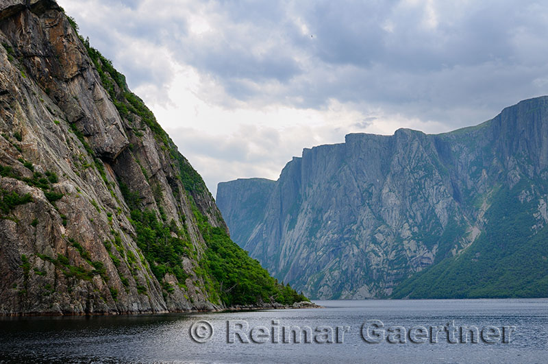 Steep towering Igneous rock walls at Western Brook Pond inland fjord at Gros Morne National Park Newfoundland