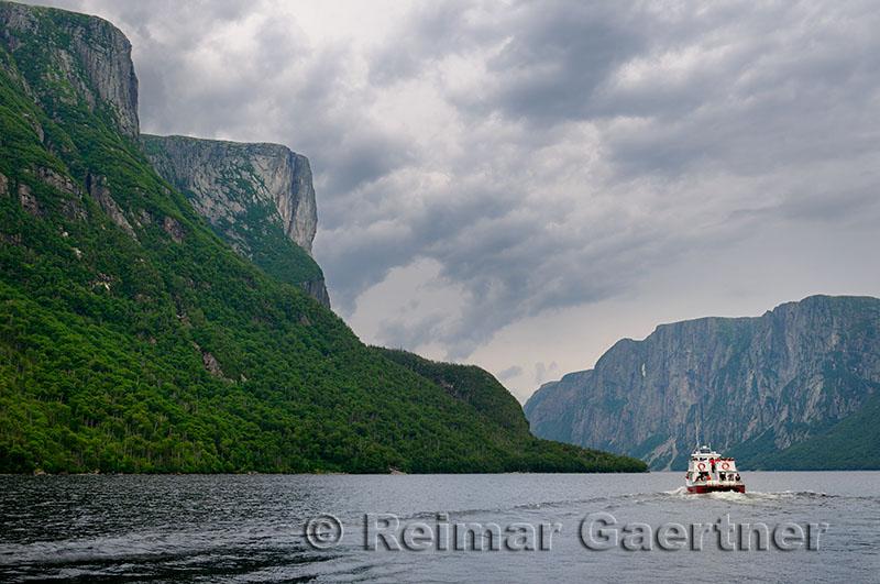 Steep cliffs of inland fjords at Western Brook Pond boat tour at Gros Morne National Park Newfoundland