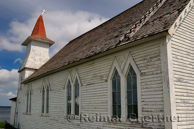Christ Anglican Church with bent steeple and cross at Clarkes Head Gander Bay Newfoundland