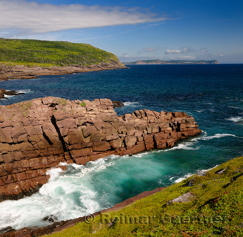 Rocky coast and surf at Cape Spear National Historic Site Newfoundland Canada