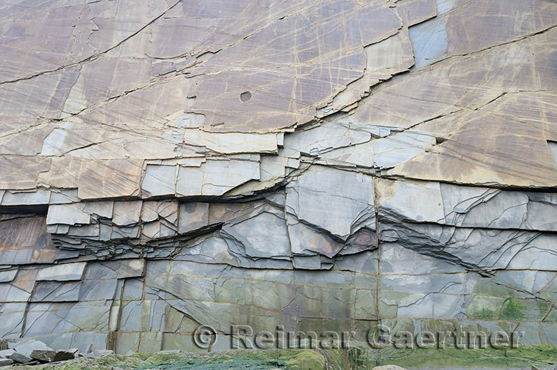 Abstract pattern of vertical layers of stone at Cape Enrage New Brunswick cliff face