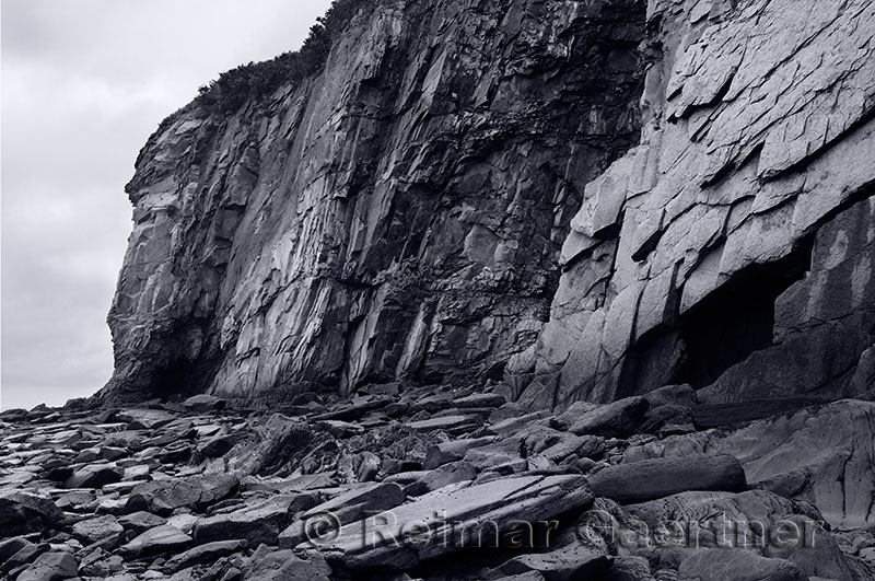 Black and white image of sheer rock cliff face at Cape Enrage New Brunswick