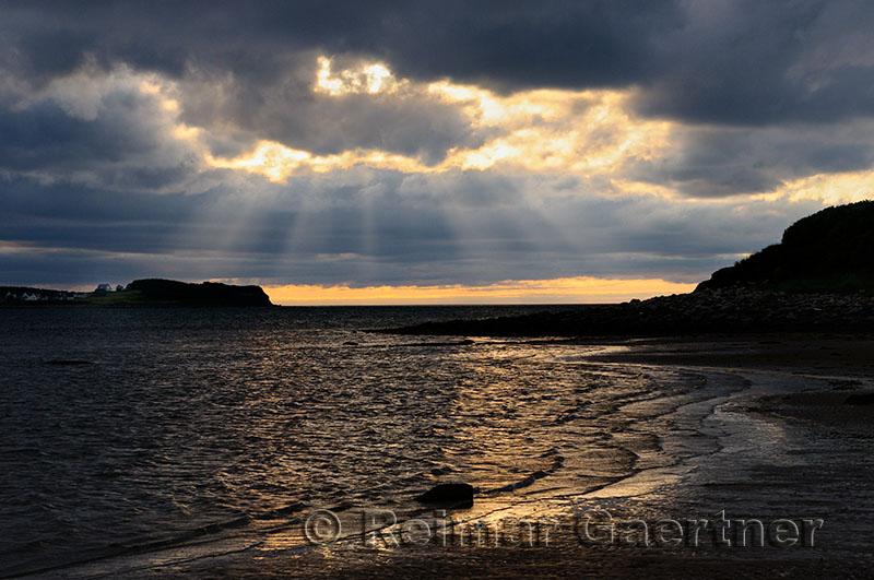 Shafts of sunlight at Port Hood shores Cape Breton Island Nova Scotia
