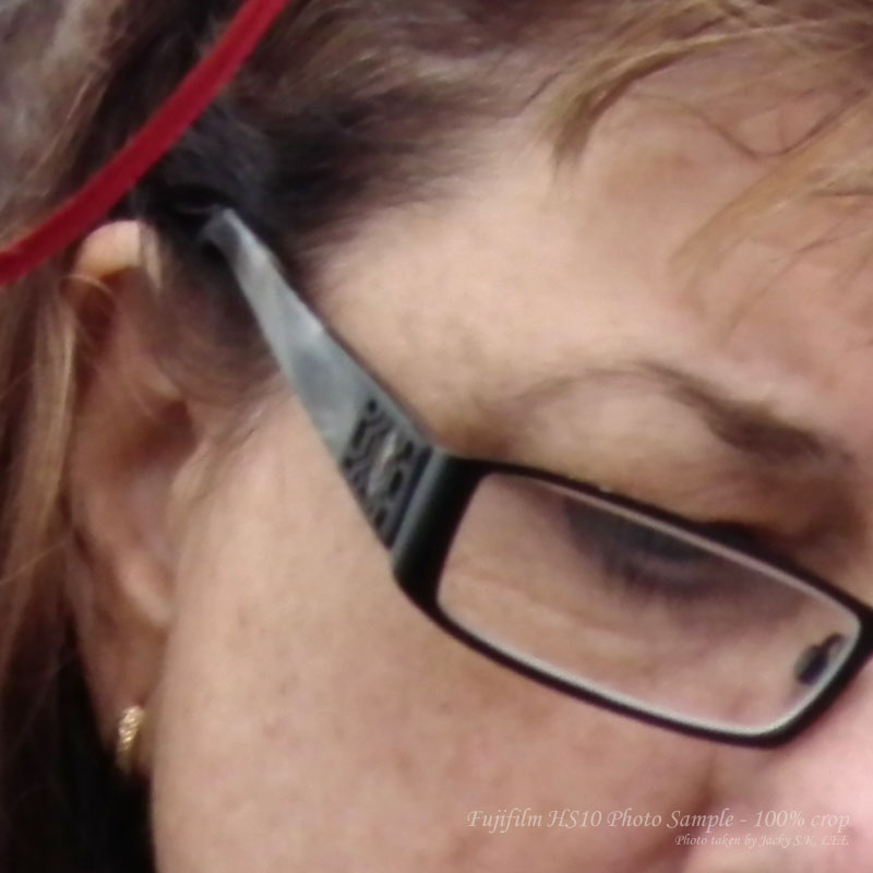100% crop (details in the glasses)