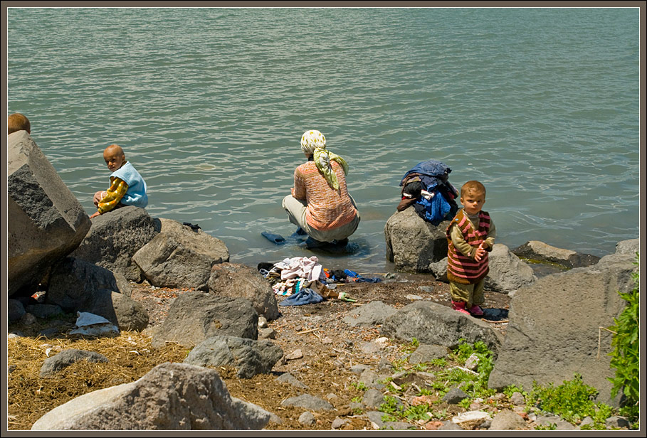 Washing clothes in lake Cildir