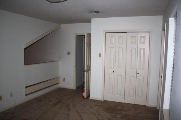 Upstars Bedroom with loft over dining area