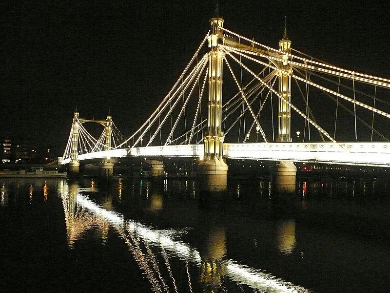 The  Albert  Bridge , illuminated,  at  night.
