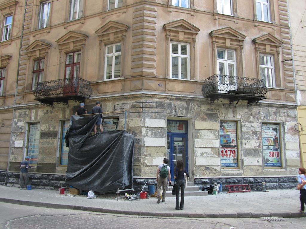 meanwhile, on the corner, some facade work has uncovered old Jewish market signs...