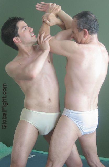dad arm wrestling wrasling younger son.jpg