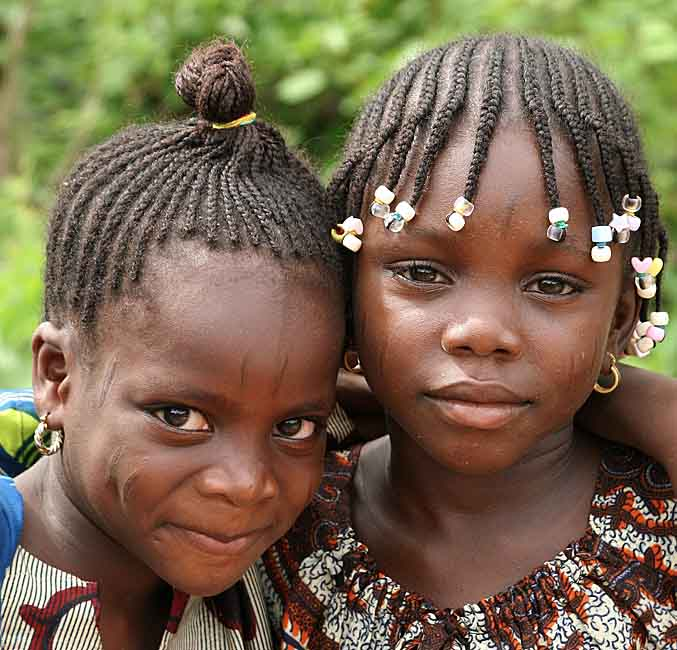 Little sisters in Benin with typical scars in their faces.