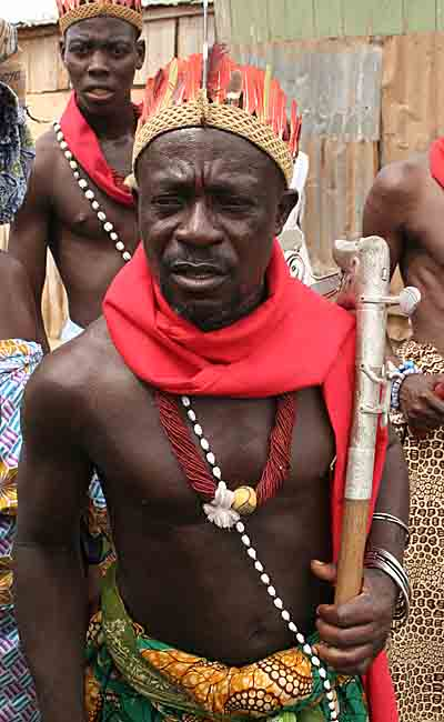 Voodoo priest leading a religious procession.