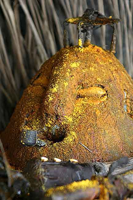 Voodoo. Vodun at Houndjohoundji smoking a pipe.