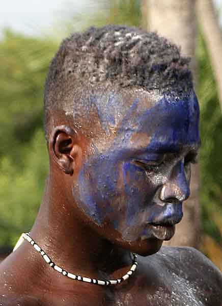 Voodoo. Another man in trance, here also blue powder is put in the face.