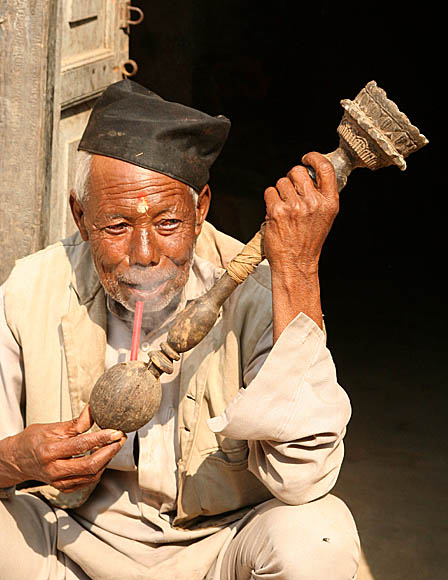 Smoking a Nepali pipe.