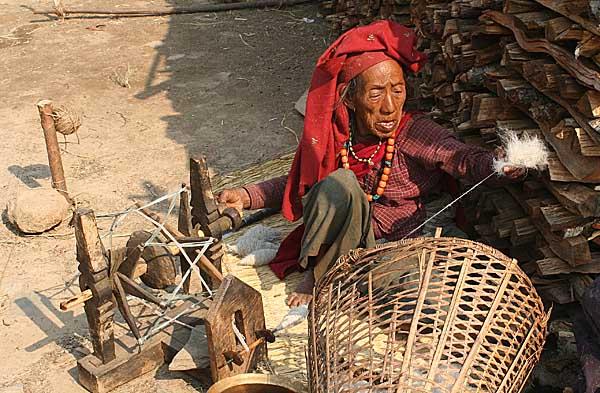 Lady spinning wool in Ghale Gaun, Nepal.