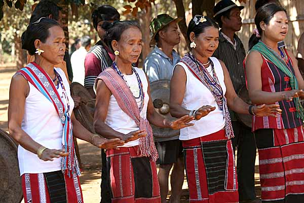 Kreung women sing and dance. A celebration at the beginning of the harvest season.