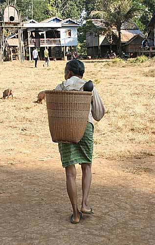 Woman with traditional basket in Nong Leg village, Cambodia.