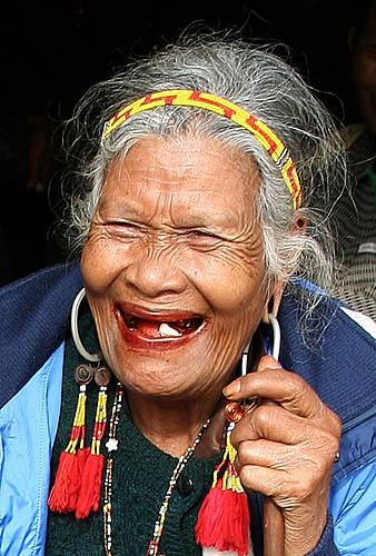 Old Phnong lady with traditional earrings. Pu Tang Village, Mondulkiri, Cambodia