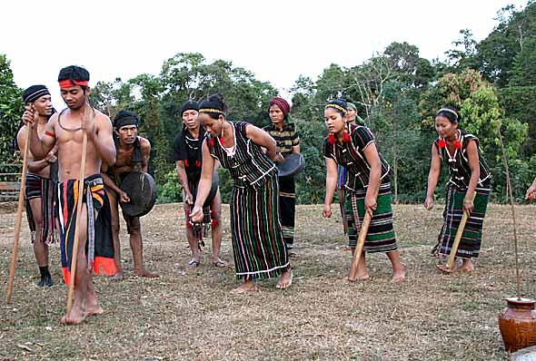 Ceremonial dance, imitating the sowing of rice. Phnong village Pu Tang, Mondulkiri, Cambodia