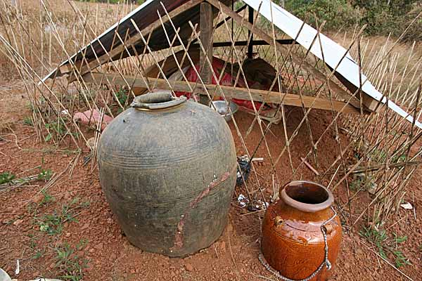 Grave of a male Phnong with jars for rice wine. Mondulkiri, Cambodia