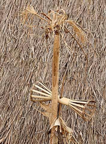 Magic pole with symbolic baskets for offerings. Pu Tang Village, Mondulkiri, Cambodia