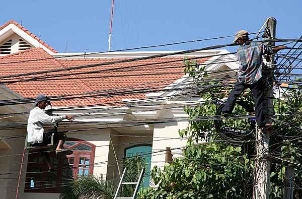 Repair of power cables in Seam Reap, Cambodia.