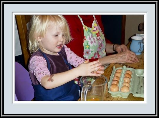 Eloise Cracking An Egg, P1010247.jpg