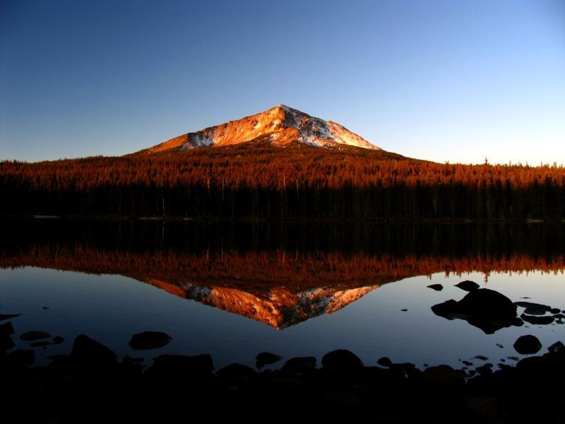 Sunrise on Mt McLoughlin across Squaw lake