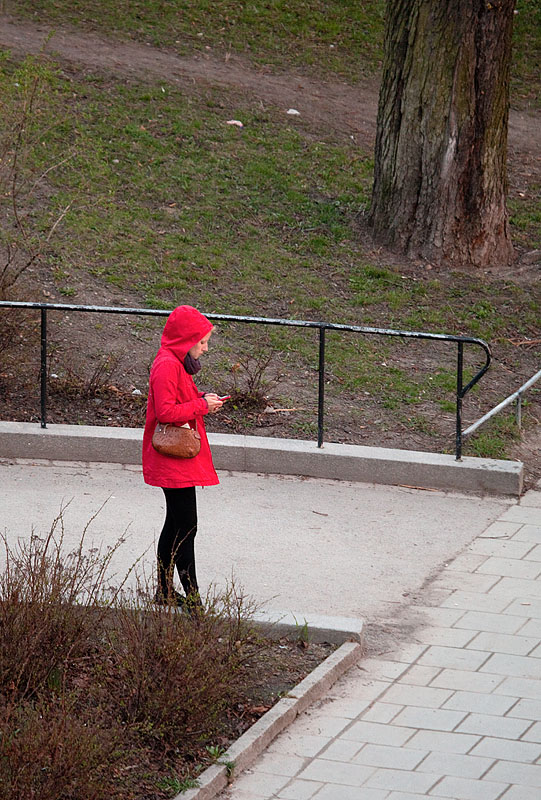 Lady in red in the still not so green park