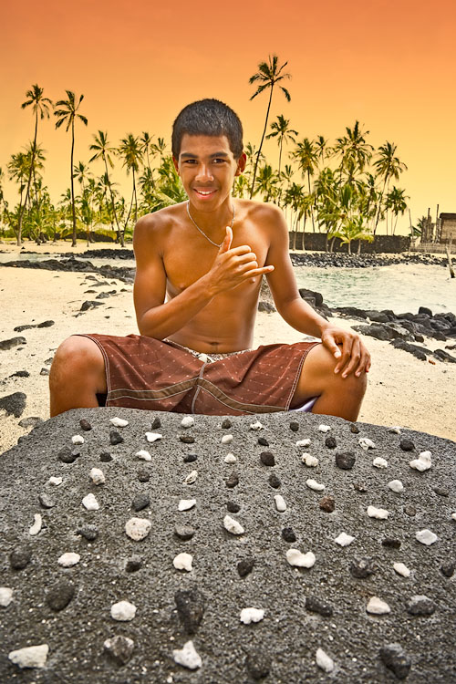 Boy playing konane (Hawaiian checker board game)