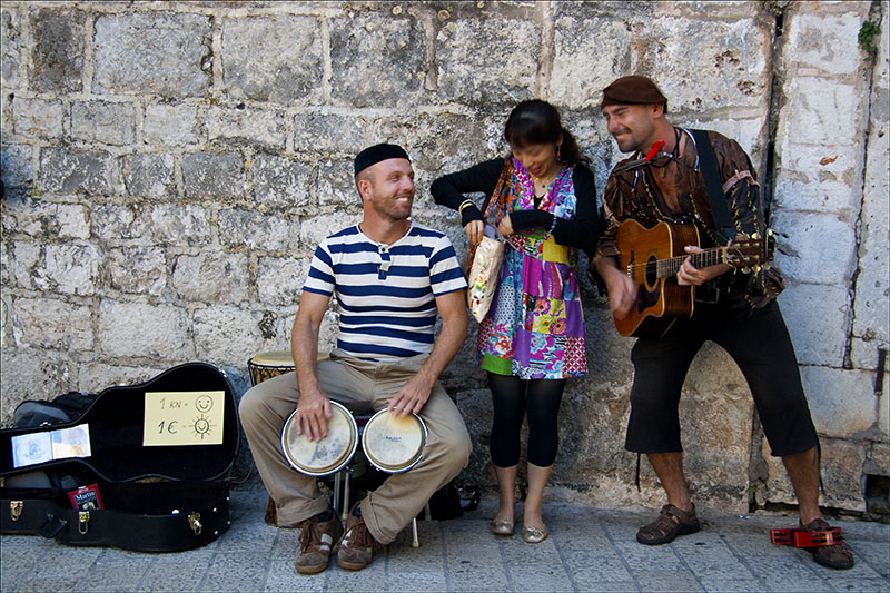 The Musicians and the Tourist.jpg