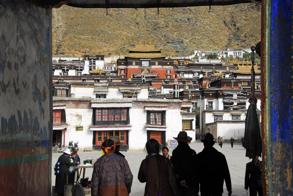 Tibetans entering Tashilhunpo Monastery through the main gate