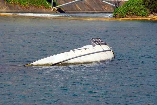 Wreck of a small boat, Aqua World Marina
