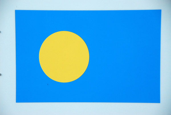 The flag of the Republic of Palau, independent since 1994 with pop. 20,600 located 1300 km SSW of Guam and 1600 km SE of Manila
