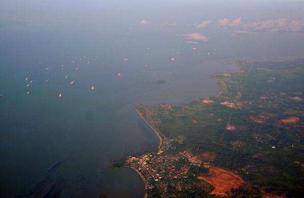 Ships moored in the Singapore Strait off Sungai Rengit (Johor) Malaysia