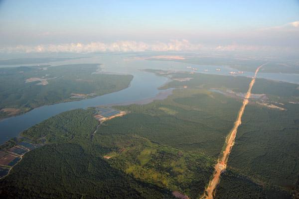 Senai-Desaru Expressway E22 being cut through the palm oil plantations of Johor, Malaysia